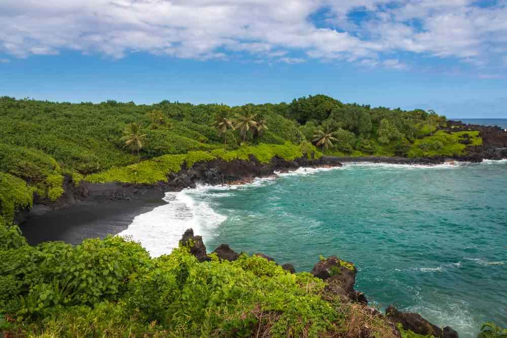 Road to Hana Guide: 15 Things to Know Before You Drive the Road to Hana featured by top Hawaii blog, Hawaii Travel with Kids: Waianapanapa Black Sand Beach on the Hawaiian island of Maui along Road to Hana, USA