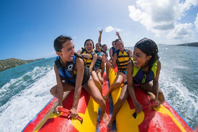25 Amazing activities in Waikiki with kids featured by top Hawaii blog, Hawaii Travel with Kids: Waikiki Banana Boat