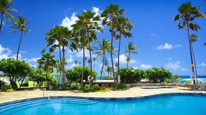Hawaii on a Budget: Top 10 Cheap Places to Stay in Kauai, featured by top Hawaii travel blog, Hawaii Travel with Kids: https://hawaiitravelwithkids.com/wp-content/uploads/2020/06/GI_poolblue_17_698x390_FitToBoxSmallDimension_Center.jpg