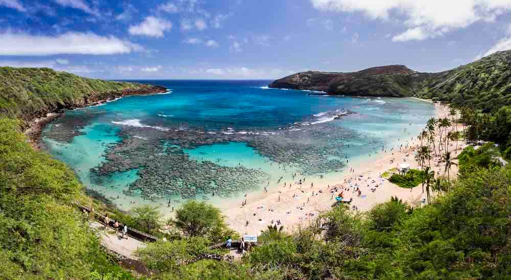 17 Historical Places in Hawaii to Visit with Kids featured by top Hawaii blog, Hawaii Travel with Kids: Snorkelling at the coral reef of Hanauma Bay, a former volcanic crater, now a national reserve