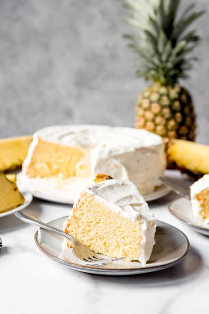 Pineapple Dessert Recipe Roundup by top Hawaii blog Hawaii Travel with Kids: An image of a slice of light and fluffy pineapple sponge cake.