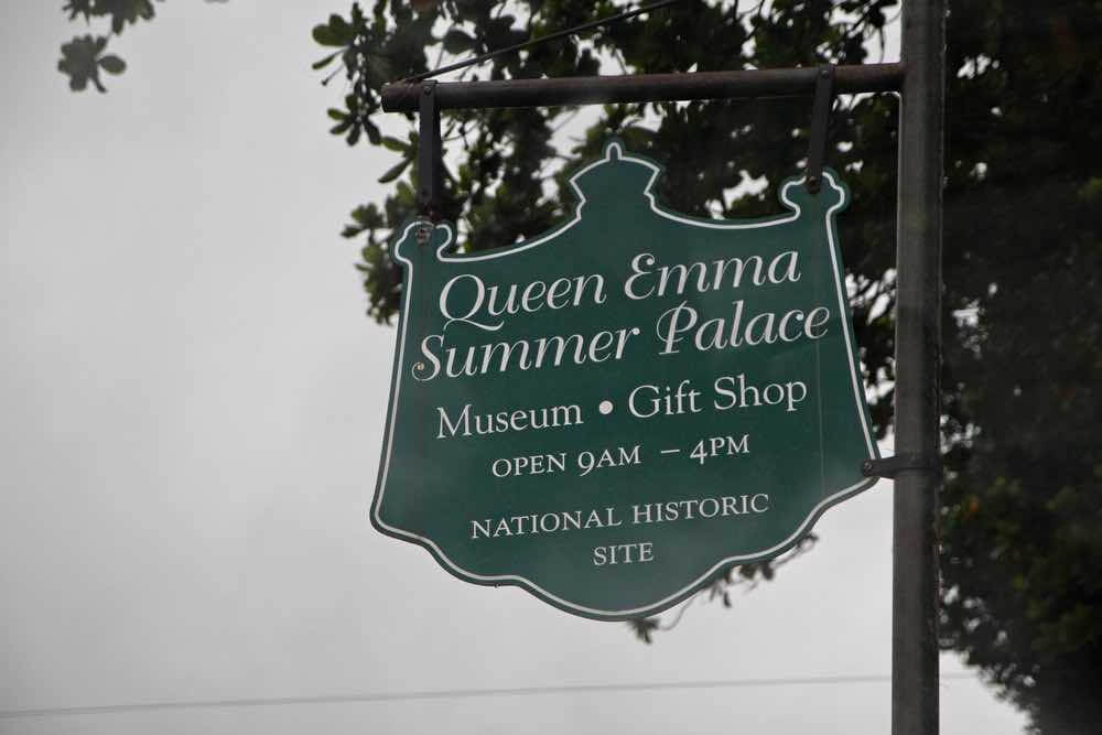 17 Historical Places in Hawaii to Visit with Kids featured by top Hawaii blog, Hawaii Travel with Kids: Honolulu, Hawaii-September 2015: Sign outside the Queen Emma Summer Palace museum and gift shop, a National Historic Site in Honolulu.