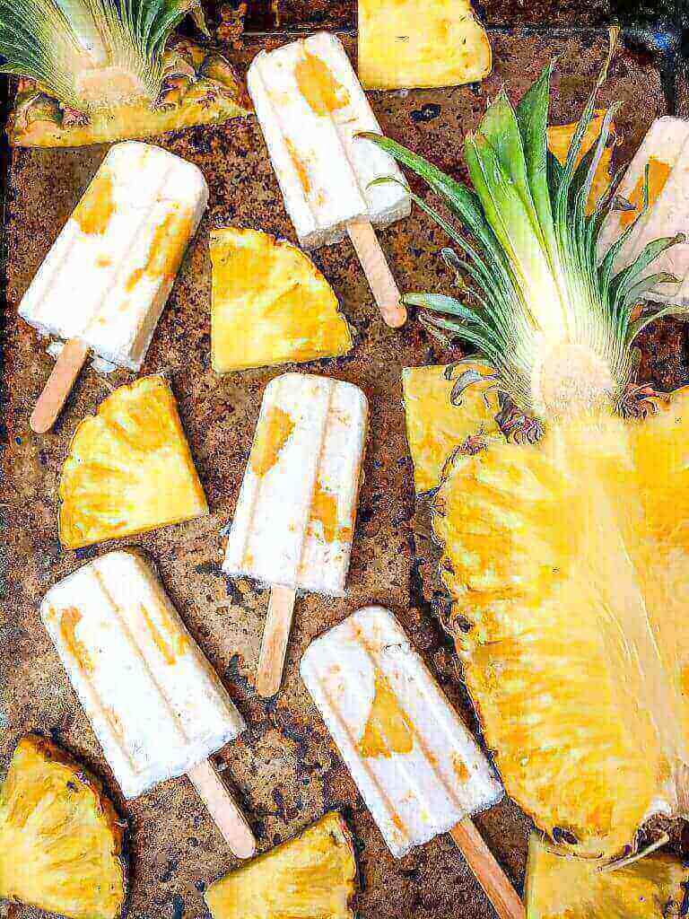 Pineapple Dessert Recipe Roundup by top Hawaii blog Hawaii Travel with Kids: Pina Colada Popsicles are easy and healthy homemade popsicles made with coconut milk and pineapple. Add rum if desired for an alcohol popsicle poptail. Gluten free and vegan. #homemadepopsicles #pinacolada #coconutpopsicles