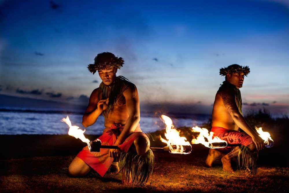 Top 10 Romantic Hawaii Beach Proposal Ideas + Locations featured by top Hawaii blog, Hawaii Travel with Kids: Two Hawaiian Men preparing to Dance with Fire in Maui