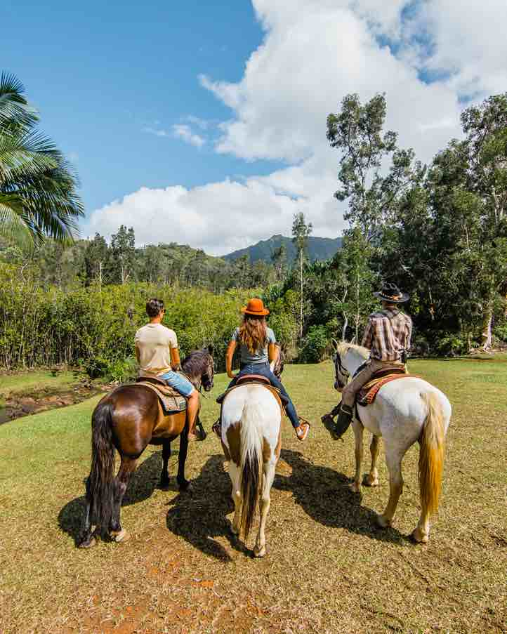 101 Best Things to Do on Kauai with Kids featured by top Hawaii blog, Hawaii Travel with Kids: One of the best things to do on Kauai is go horseback riding