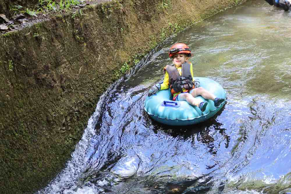 101 Best Things to Do on Kauai with Kids featured by top Hawaii blog, Hawaii Travel with Kids: A fun kid-friendly Kauai adventure is going mountain tubing