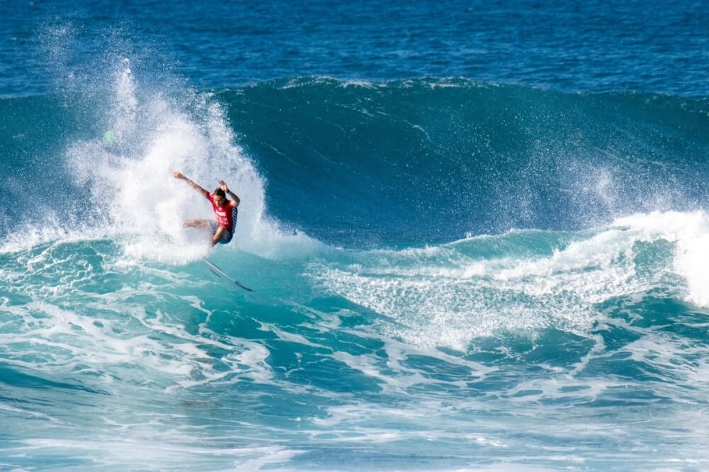Oahu Surfing On The North Shore, a complete guide featured by top Hawaii blog, Hawaii Travel with Kids: Sheldon Simkus at the Vans World Cup of Surfing. Photo credit: WSL/Keoki