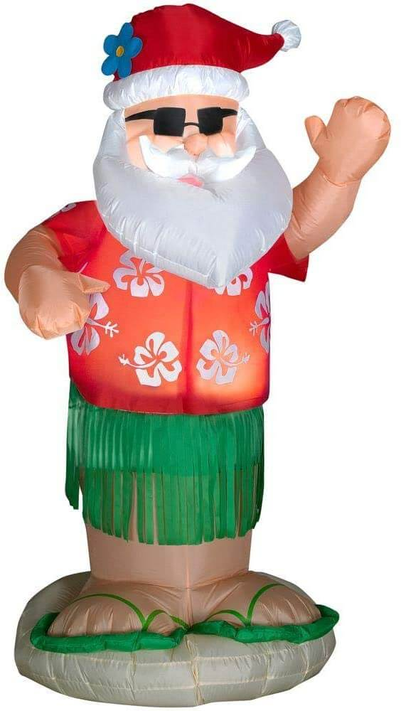 Best Hawaiian Christmas Decorations featured by top Hawaii blogger, Hawaii Travel with Kids: Add some Hawaiian Christmas decorations to your home this holiday season with these top Hawaii Christmas decorations ideas from top Hawaii blog Hawaii Travel with Kids. Image of Hawaiian Santa Inflatable
