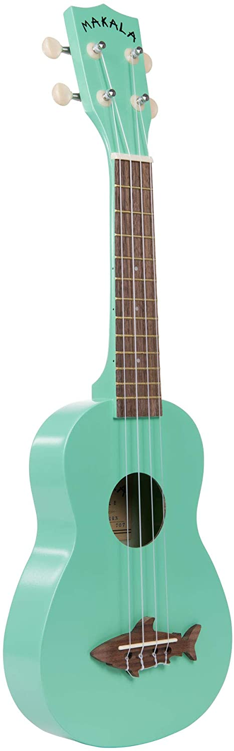 Find out the best toddler ukulele to buy in this ukulele guide by top Hawaii blog Hawaii Travel with Kids. Image of a Makala ukulele