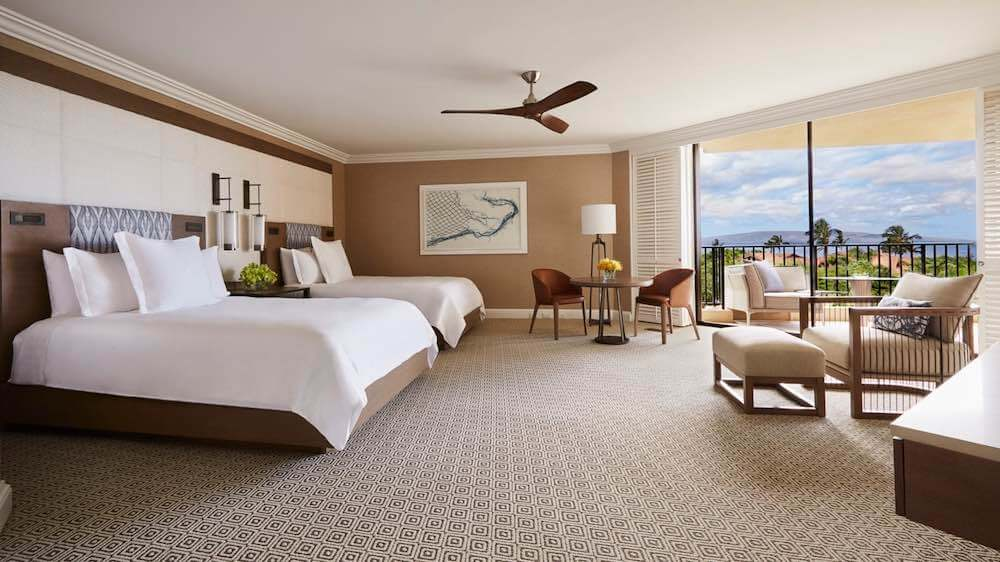 Top 5 Best Maui Luxury Hotels featured by top Hawaii blogger, Hawaii Travel with Kids: The Four Seasons Maui is a gorgeous Maui luxury resort. Image of the interior of a Four Seasons Maui room