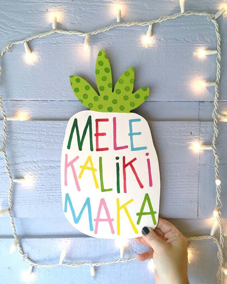 Best Hawaiian Christmas Decorations featured by top Hawaii blogger, Hawaii Travel with Kids: Add some Hawaiian Christmas decorations to your home this holiday season with these top Hawaii Christmas decorations ideas from top Hawaii blog Hawaii Travel with Kids. Image of Mele Kalikimaka pineapple sign Christmas decor tropical