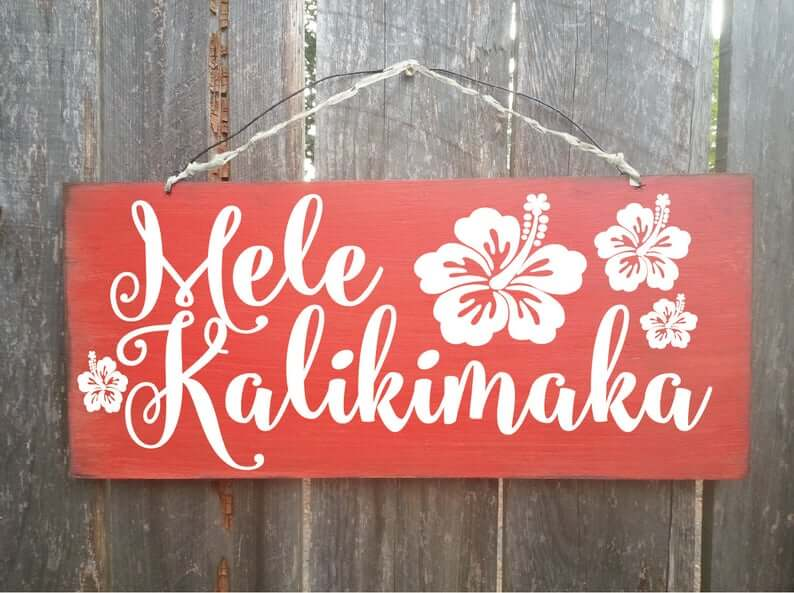 Best Hawaiian Christmas Decorations featured by top Hawaii blogger, Hawaii Travel with Kids: Add some Hawaiian Christmas decorations to your home this holiday season with these top Hawaii Christmas decorations ideas from top Hawaii blog Hawaii Travel with Kids. Image of Mele Kalikimaka sign Hawaiian Christmas