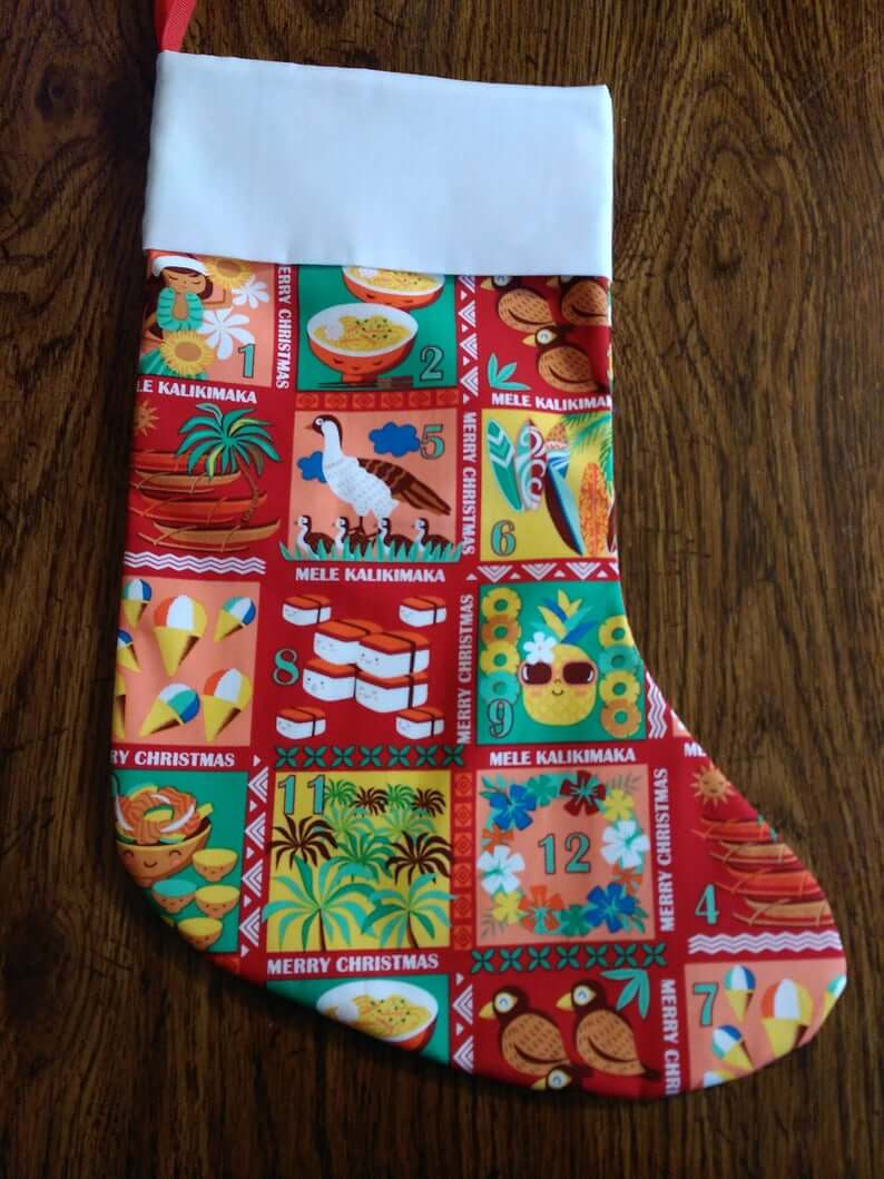 Best Hawaiian Christmas Decorations featured by top Hawaii blogger, Hawaii Travel with Kids: Add some Hawaiian Christmas decorations to your home this holiday season with these top Hawaii Christmas decorations ideas from top Hawaii blog Hawaii Travel with Kids. Image of Hawaiian Christmas stocking