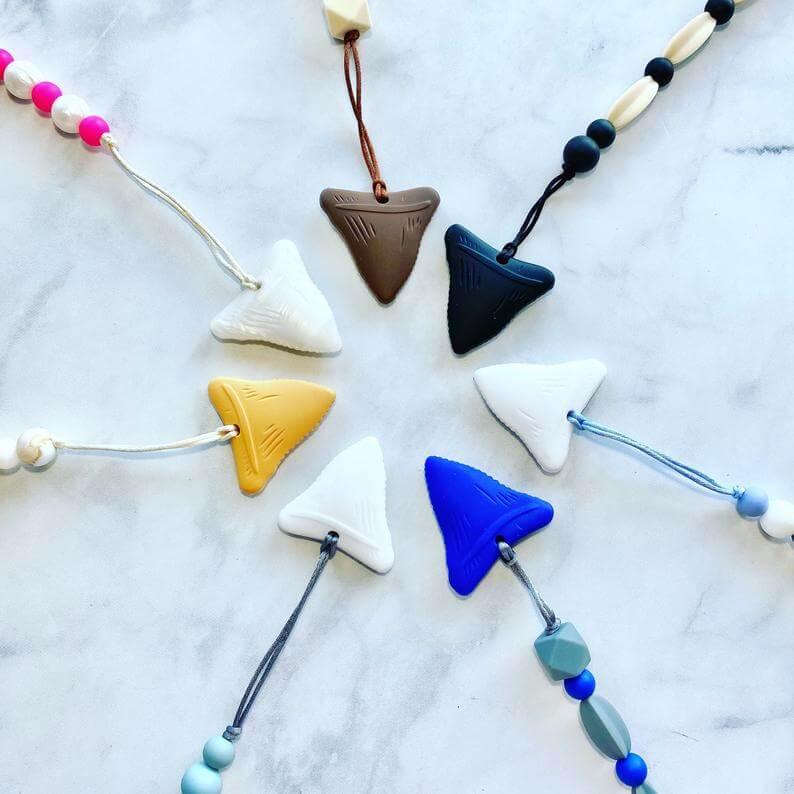 Hawaiian toys and Hawaiian gifts for kids by top Hawaii blogger Hawaii Travel with Kids: Shark Tooth Silicone Teether on Pacifier Clip Hawaiian Style image 0