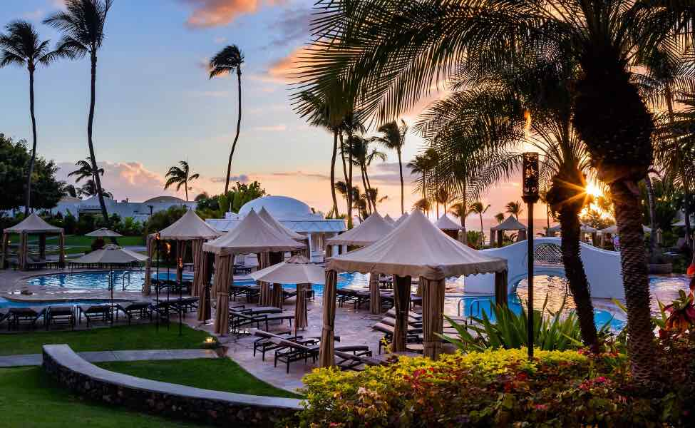 Top 5 Best Maui Luxury Hotels featured by top Hawaii blogger, Hawaii Travel with Kids: The Fairmont Kea Lani is one of the best Maui luxury hotels. Image of the pool area at this Maui hotel