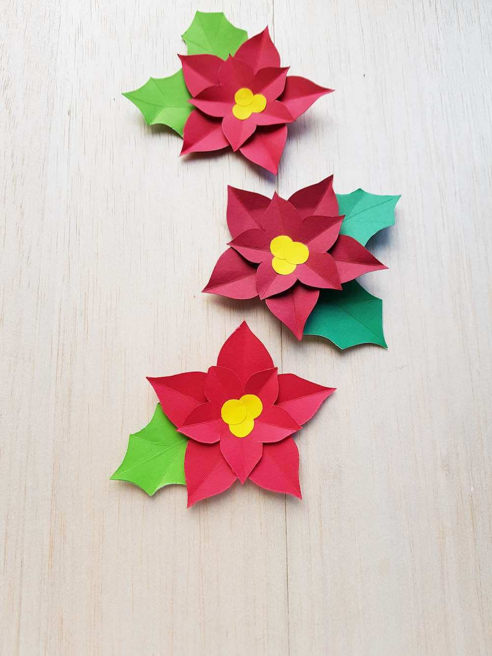 How to Make a Paper Poinsettia Craft, a tutorial featured by top Hawaii blog, Hawaii Travel with Kids: Finished paper poinsettia craft