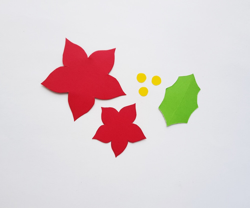How to Make a Paper Poinsettia Craft, a tutorial featured by top Hawaii blog, Hawaii Travel with Kids: Image of individual paper pieces cut out on a table
