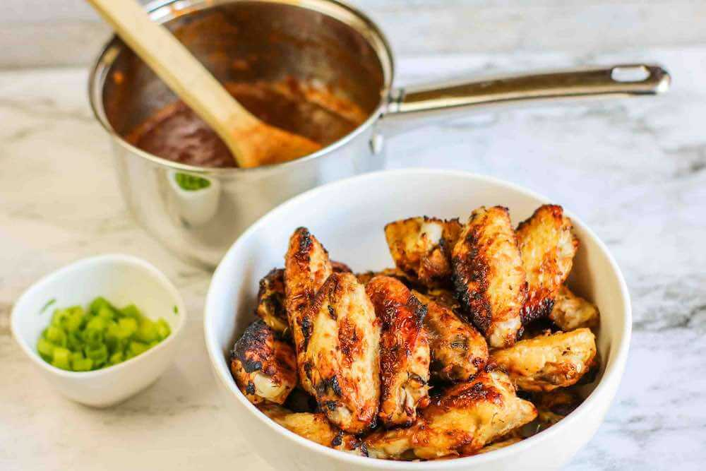 Air Fryer Hawaiian BBQ Chicken Wings Recipe featured by top Hawaii blogger, Hawaii Travel with Kids: Toss the chicken wings in the Hawaiian BBQ Sauce