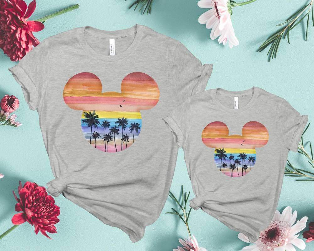 Find out the cutest Disney Aulani t-shirts to buy before your trip to Disney's Aulani Resort in Hawaii by top Hawaii blog Hawaii Travel with Kids. Get your family matching Aulani shirts like this adorable Hawaiian sunset inside a Mickey Mouse outline.