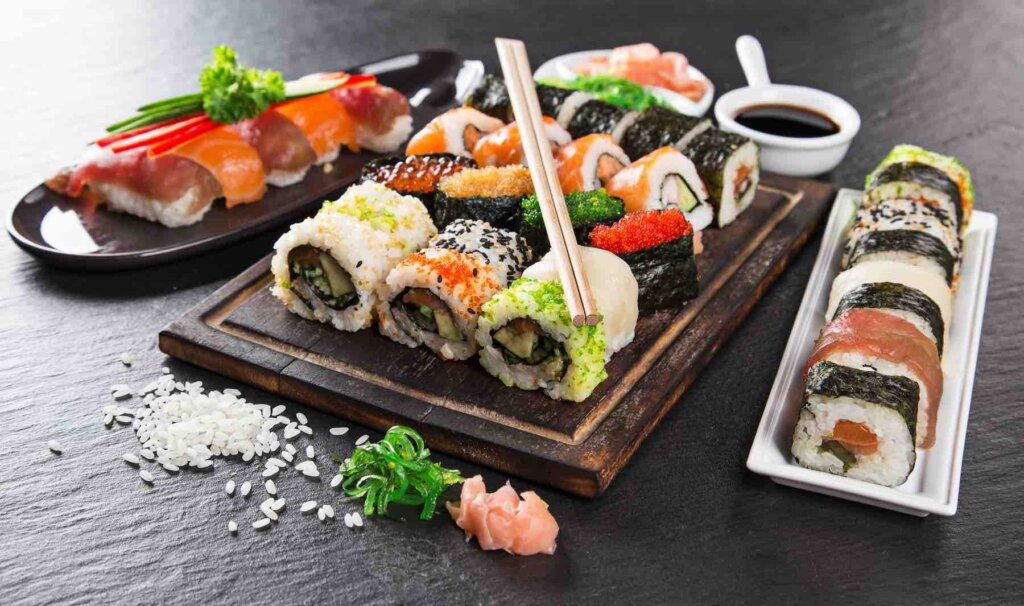 Find out the best sushi in Hawaii by top Hawaii blog Hawaii Travel with Kids. Image of a big platter of sushi.