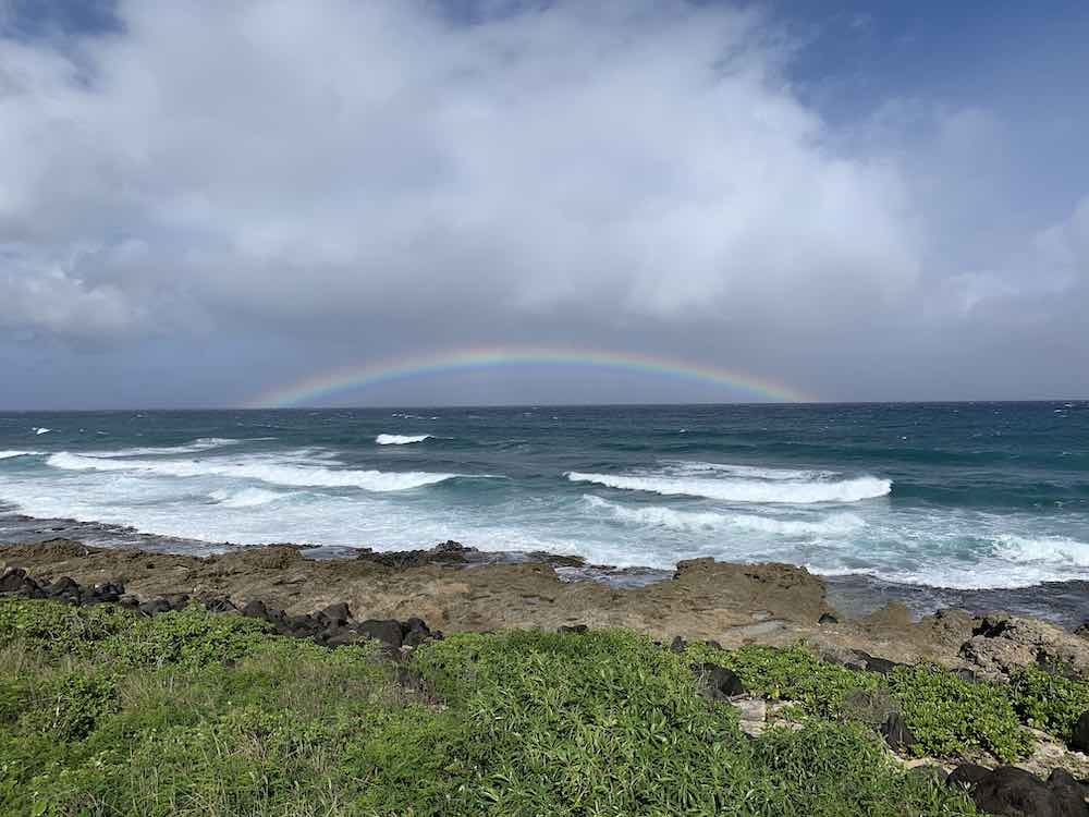 Kaena Point Hike guide featured by top Hawaii blogger, Hawaii Travel with Kids: Image of a rainbow at Kaena Point Oahu