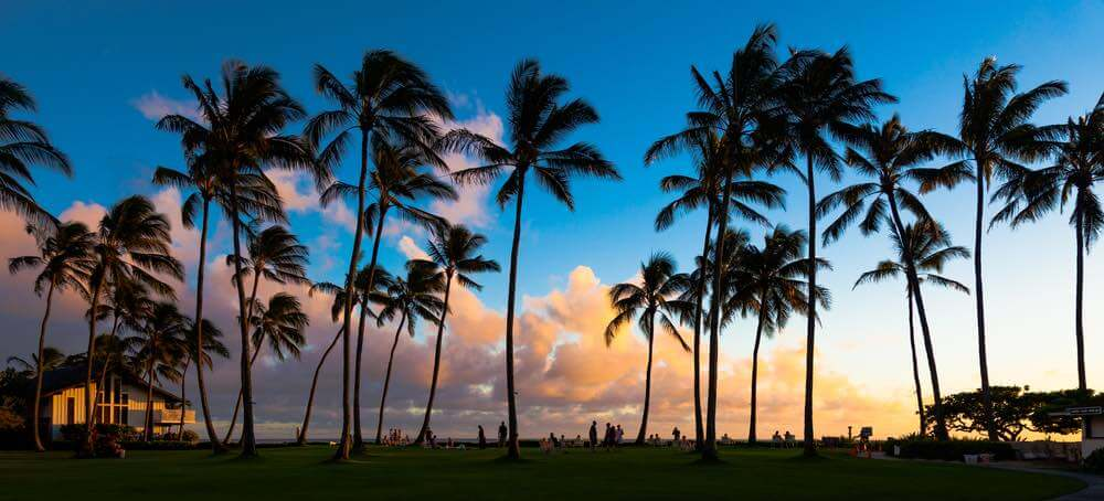 Find out the top Kauai sunset spots you'll want to experience for your next Kauai vacation. Image of Beautiful sunset at a tropical beach in Kauai, Hawaii Islands.