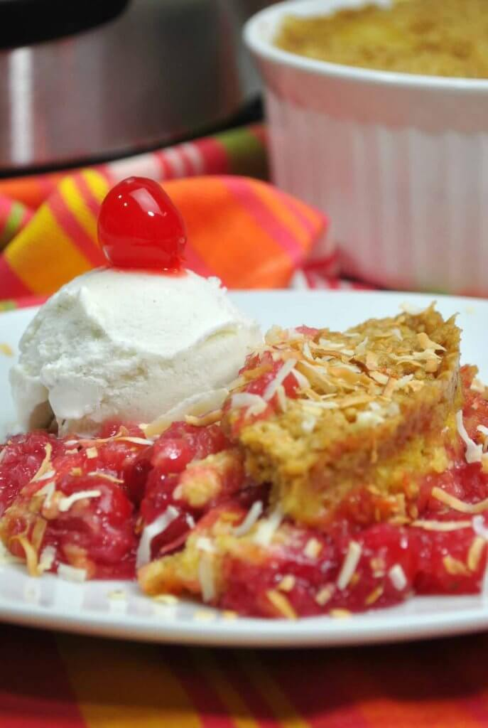 Your family will love this easy pineapple coconut cake topped with ice cream and cherries