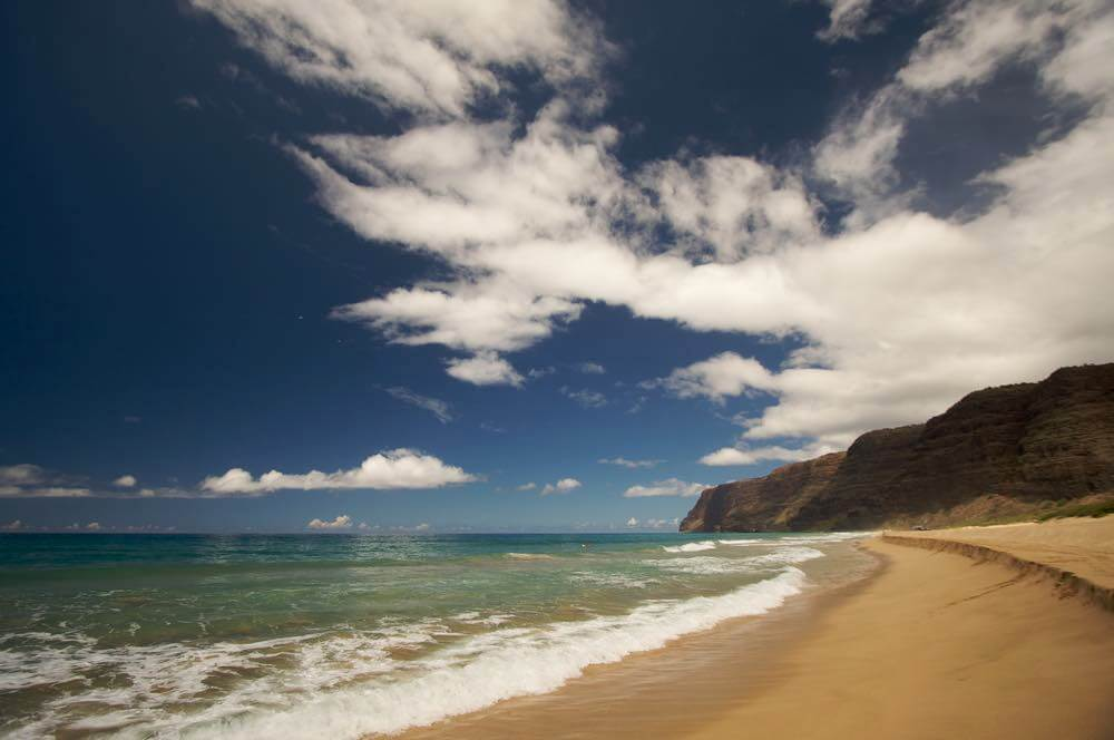 One of the best places to watch a Kauai sunset is Polihale Beach. Image of Polihale Beach on Kauai, Hawaii