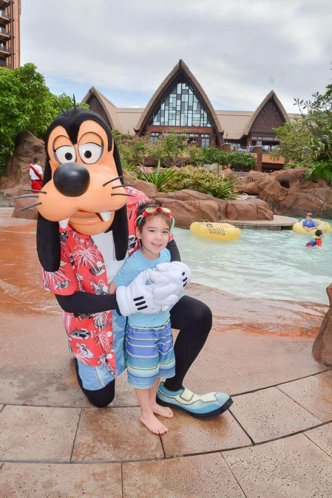 Image of a boy posing with Goofy at Disney Aulani Resort in Hawaii