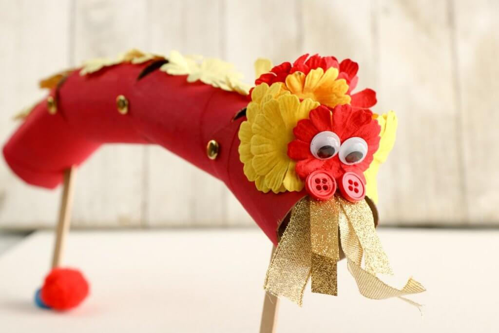 Find out how to make Chinese dragon puppets with this detailed Chinese New Year craft tutorial. Image of a cardboard Chinese dragon craft.