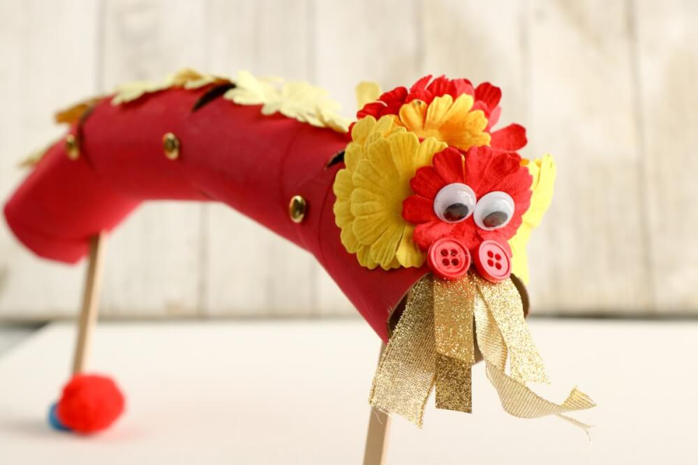 Learn how to make this Chinese dragon puppet. which is a great Chinese New Year craft for kids. Image of a cardboard Chinese New Year dragon.