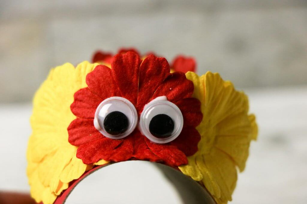 Decorate your Chinese dragon puppet with flowers, buttons, and googly eyes. Image of a Chinese New Year dragon craft.