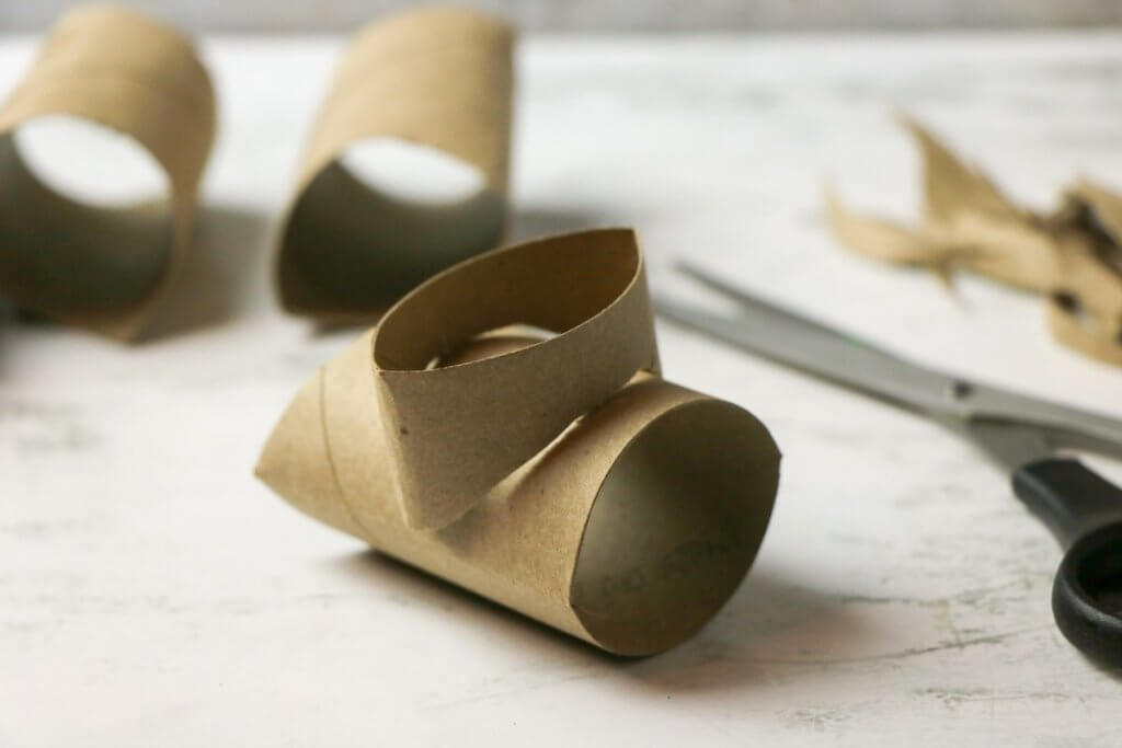 Fit the cardboard tubes together to form the Chinese dragon puppet head. Image of cardboard tube pieces fitted together.