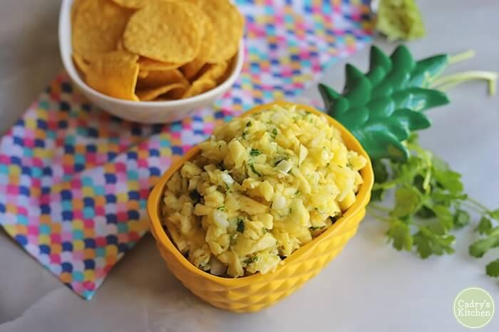 Learn how to make fresh pineapple salsa. Image of pineapple salsa in a pineapple dish.