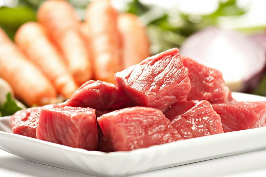 Learn how to make Hawaiian beef stew from top Hawaii blog Hawaii Travel with Kids. Image of beef cubes and carrots.