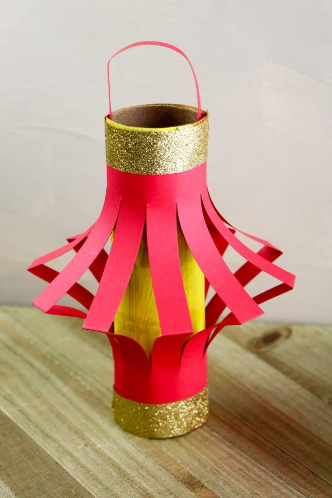 DIY Chinese lantern crafts for kids by top Hawaii blog Hawaii Travel with Kids. Image of a cardboard tube Chinese lantern