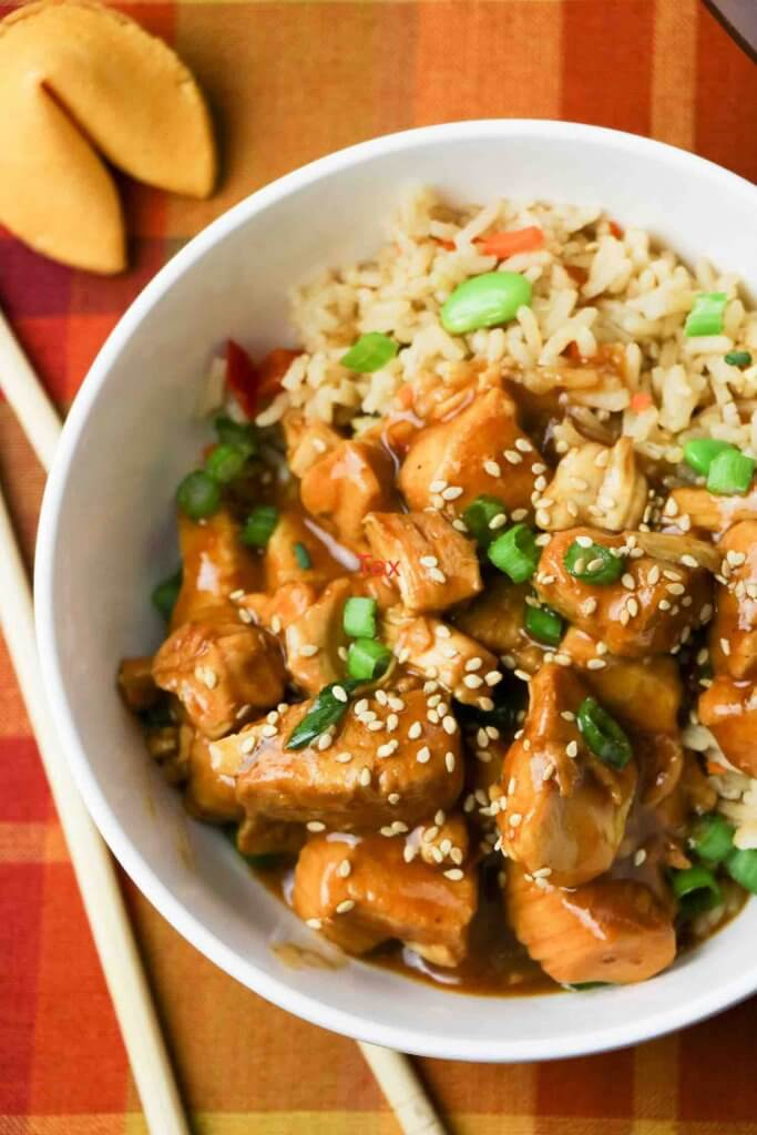 Learn how to make this easy general tso's chicken in the instant pot. Image of General Tso chicken in a bowl.