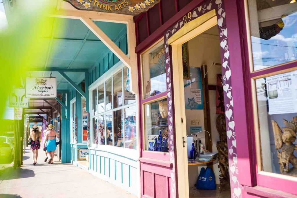 Exploring Paia Town is a top thing to do in Maui. Image of some colorful boutiques in Paia, Maui.