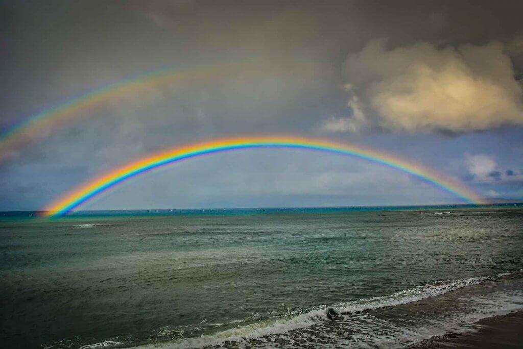 Image of a double rainbow over Kahana Beach in Maui
