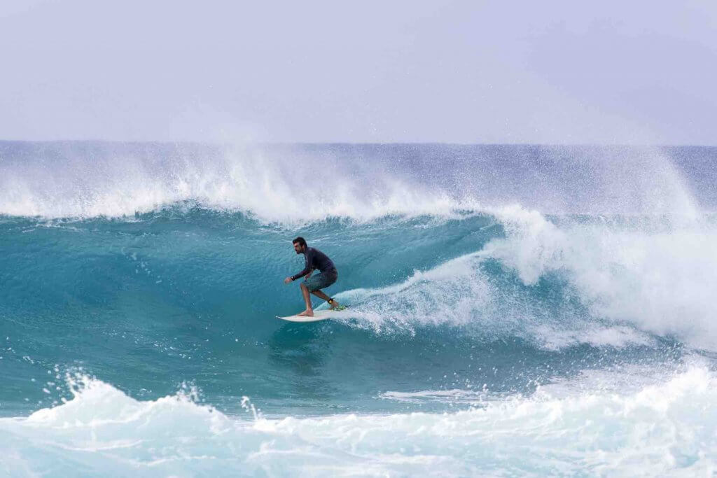 Image of A surfer riding barrels of the Banzai Pipeline, a very popular pro-surf spot at the Northshore region of O'ahu.