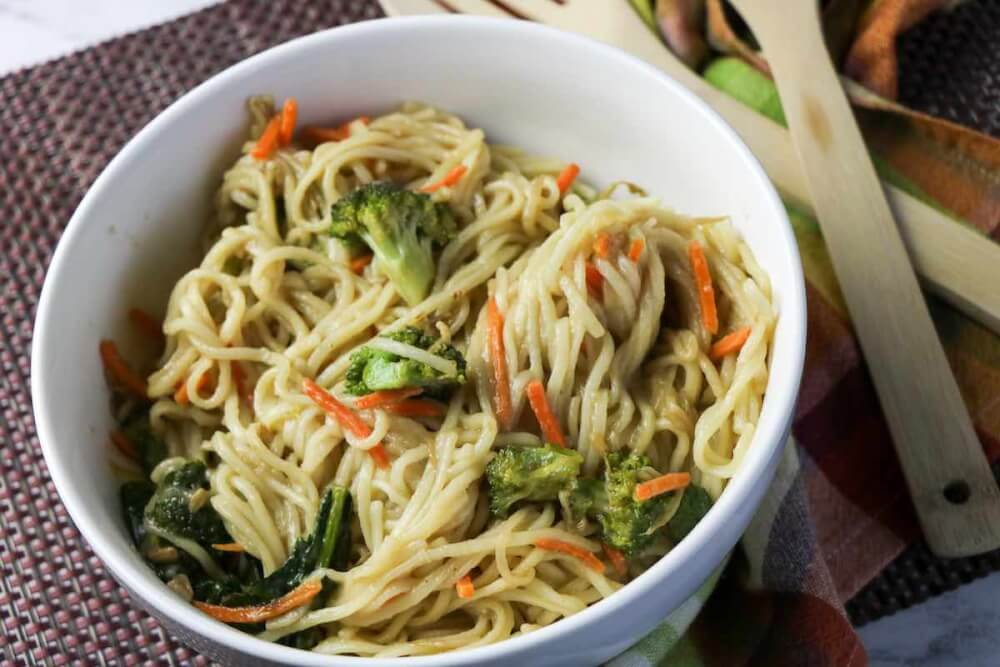 Learn now to make Vegetable Lo Mein that is a popular Chinese New Year recipe. Image of veggie lo mein in a bowl.