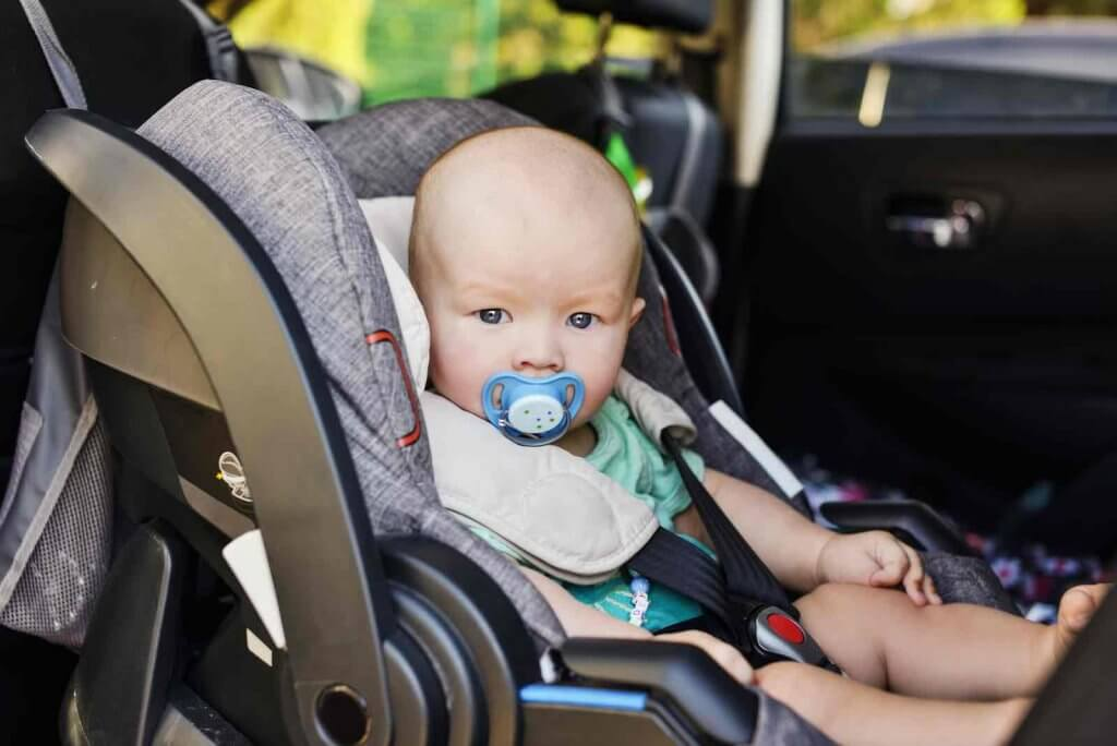 Do you need a car seat in Hawaii? Image of baby boy in the car seat in summer
