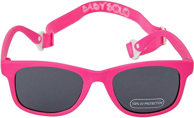 It's helpful to get baby sunglasses with a strap to ensure it stays on your baby's head. Image of a pair of pink baby sunglasses.