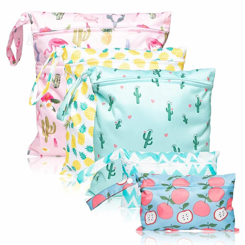 Image of 5 wet bags with fun prints like pineapples, apples, cacti, flamingos, and chevron.