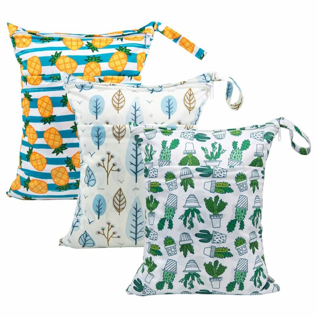 This set of wet dry bags are baby beach must haves. Image of 3 wet dry bags including pineapple print, leaves, and cacti.