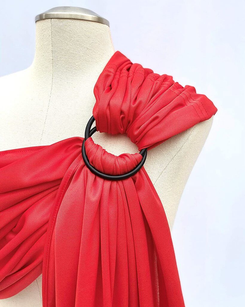 Image of a red Beachfront baby ring sling for water.