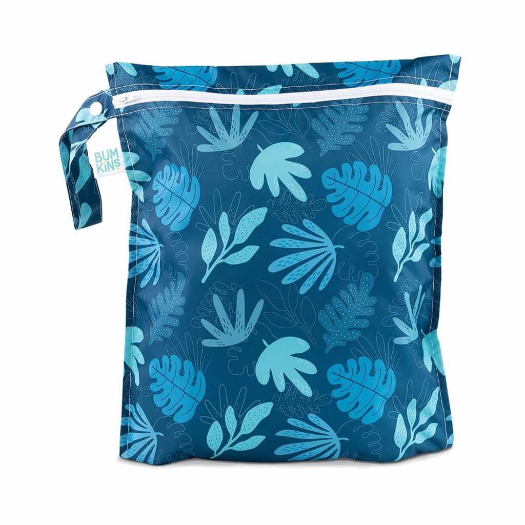 This blue tropical print wet bag is the best baby beach gear to pack in your bag. Image of a blue tropical print wet bag.