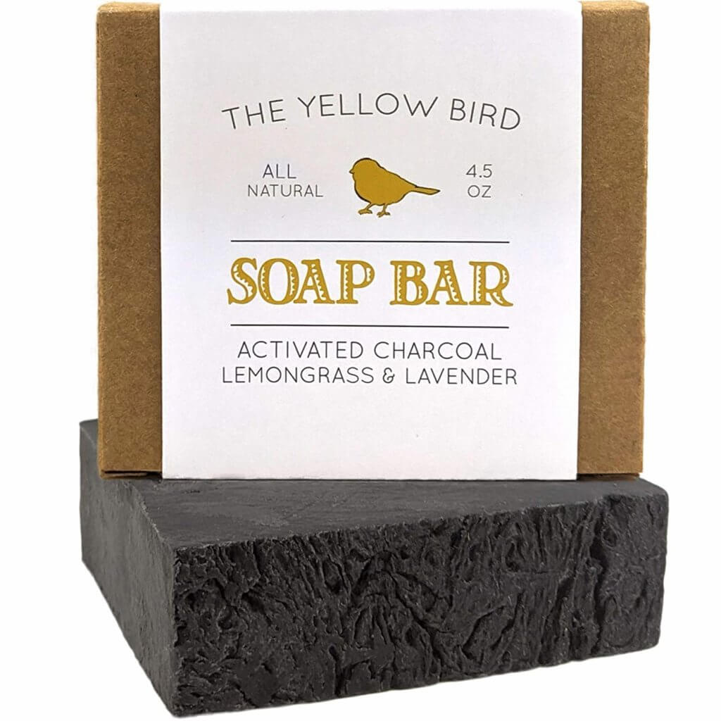 Add a charcoal soap bar to your zero waste travel kit for Hawaii. Image of a charcoal soap bar from The Yellow Bird.