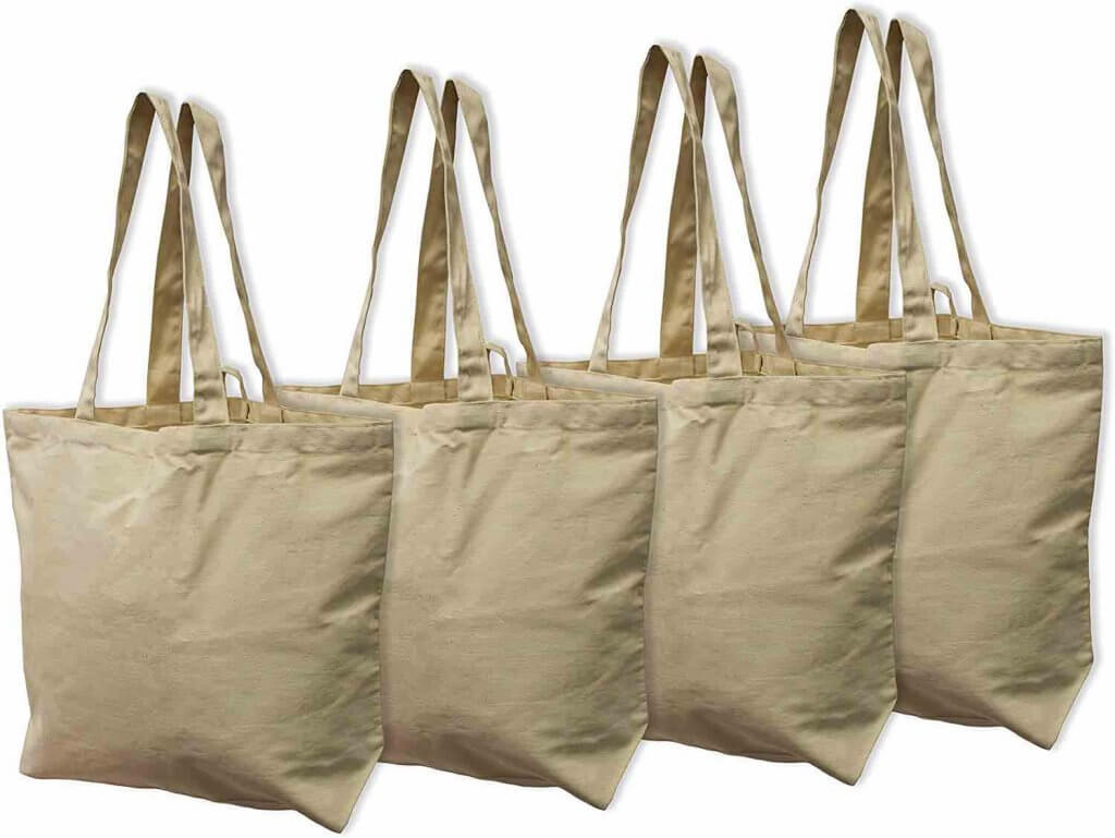 Another essential zero waste Hawaii travel item are reusable bags, since plastic bags are banned in Hawaii. Image of 4 brown organic bags.