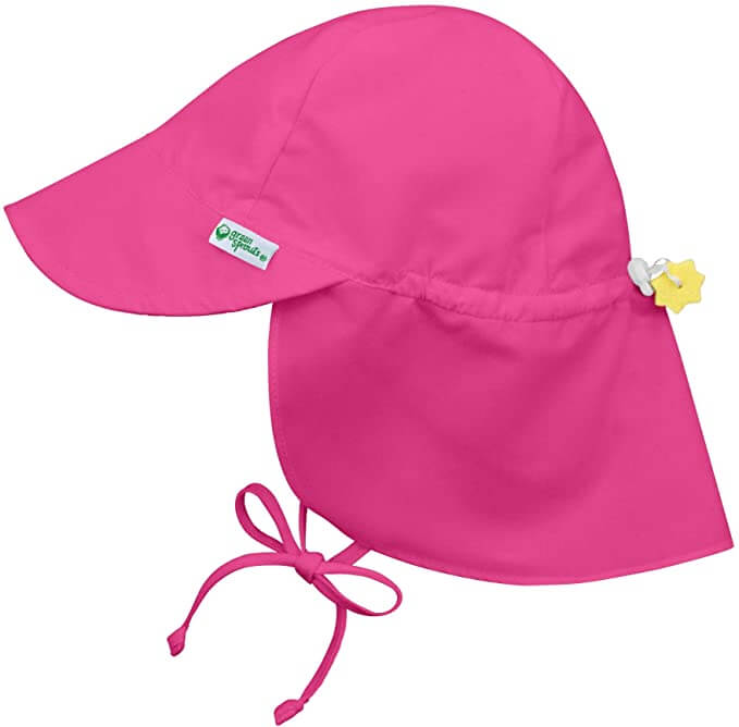 Make sure to include a sun hat in your baby beach stuff for Hawaii. Image of a bright pink sun hat with neck flap.